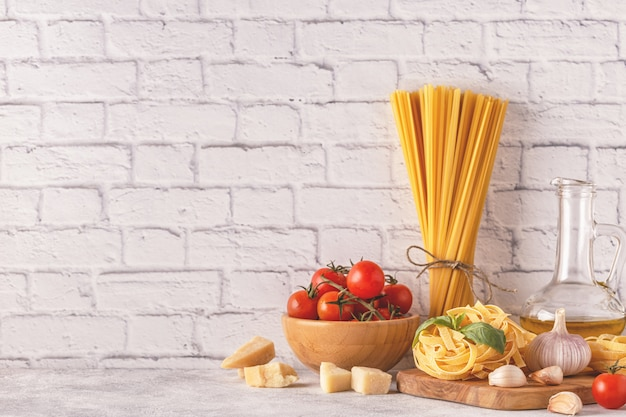 Products for cooking - pasta, tomatoes, garlic, olive oil, basil