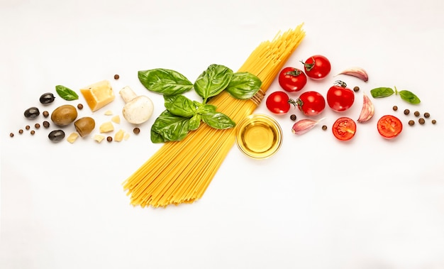 Products for cooking traditional italian pasta on white