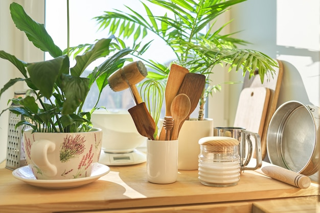 Products, kitchen utensils on the table in pantry.