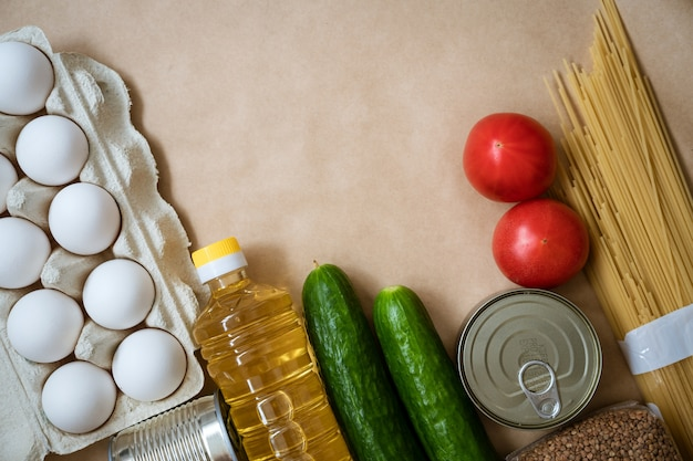 Products lie on the table, eggs cereals and vegetables