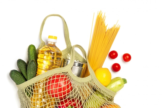 Products in a string bag on a white isolated background. the concept of green shopping and good nutrition. delivery of products.