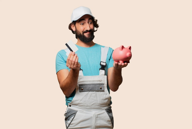 Profesional painter  with a piggy bank