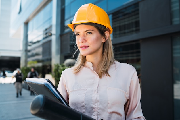 Professional architect woman standing outdoors