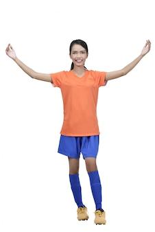 Professional asian female football player posing celebrate