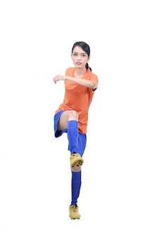 Professional asian soccer player woman kick the ball