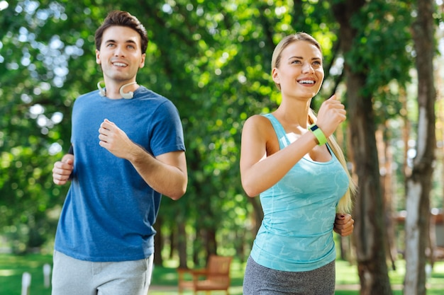 Professional athletes. happy nice people smiling while enjoying running together