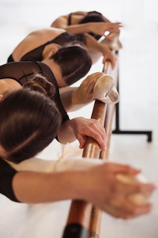 Professional ballerinas training together in pointe shoes