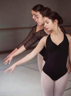 Professional ballet dancers in leotards dancing together