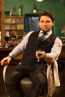 Professional barber at his barbershop