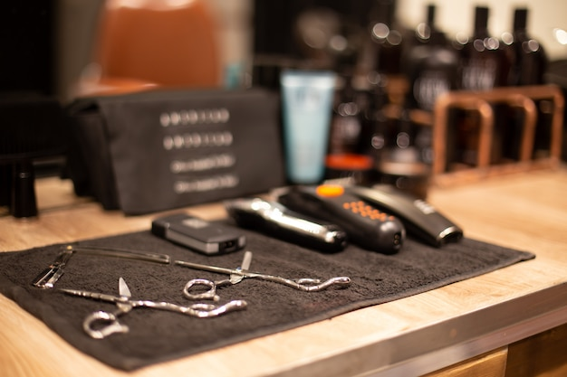 Professional barber tools in barbershop on blurred background