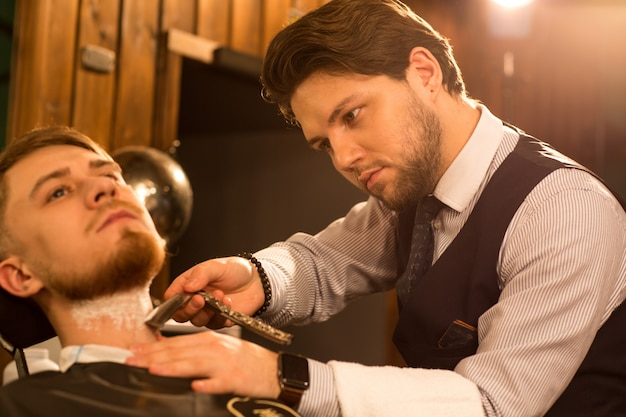 Professional barber working at his barbershop