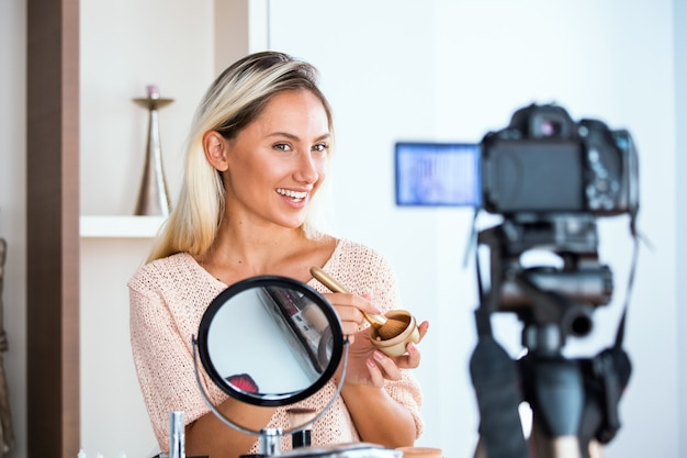 Professional beauty vlogger doing live broadcasting makeup tutorial