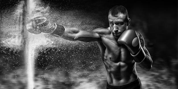 プロボクサーは手袋で障壁を破ります。ほこりやがれきがこぼれた。 3dレンダリング。スポーツの概念。ミクストメディア