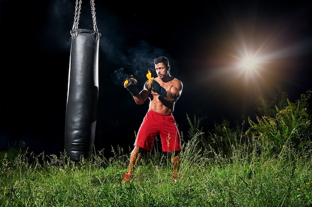 Professional boxer exercising in boxing gloves