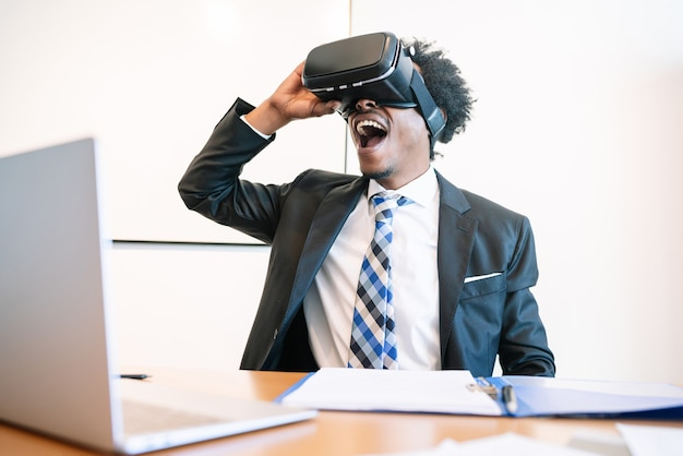 Professional businessman using virtual reality headset in modern office.
