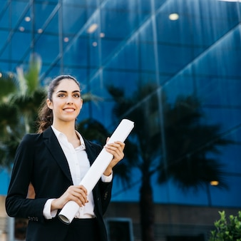 Professional businesswoman holding plan