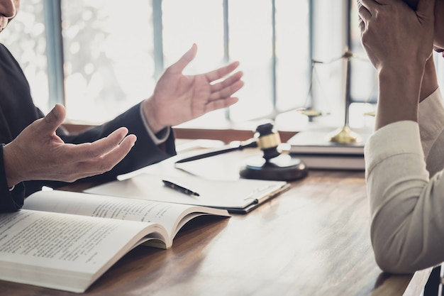 Professional businesswoman and male lawyers working and discussion having at law firm