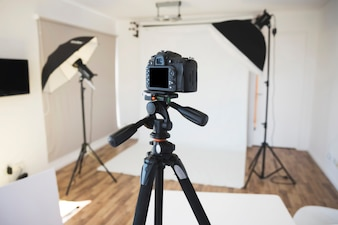 Professional camera on a tripod in modern photo studio