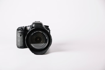 Professional camera on white background