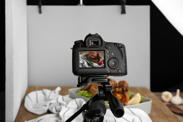 Professional camera on tripod during food photographing in studio