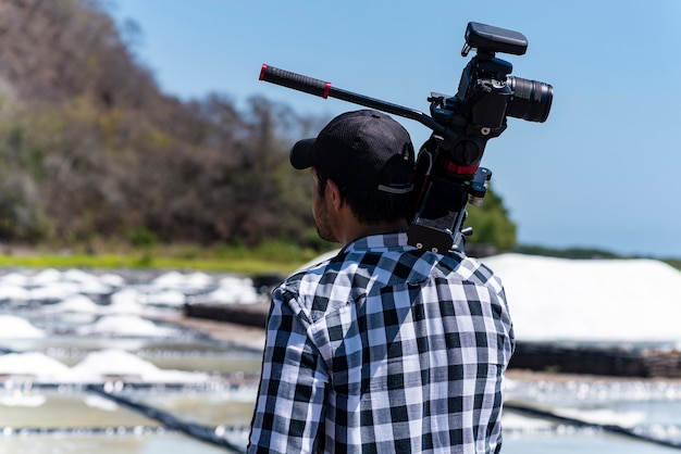 Professional cameraman behind the scenes of video production in salinas of coasts