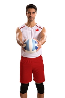 Professional canadian volleyball player with ball. isolated on white space.