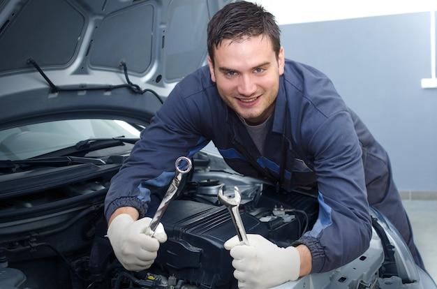 Professional car mechanic in repair shop