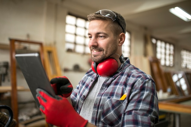 Professional carpenter in workshop