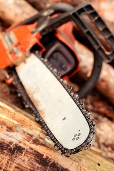 Professional chainsaw blade cutting log of wood