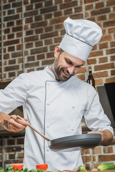 Professional chef in kitchen preparing food