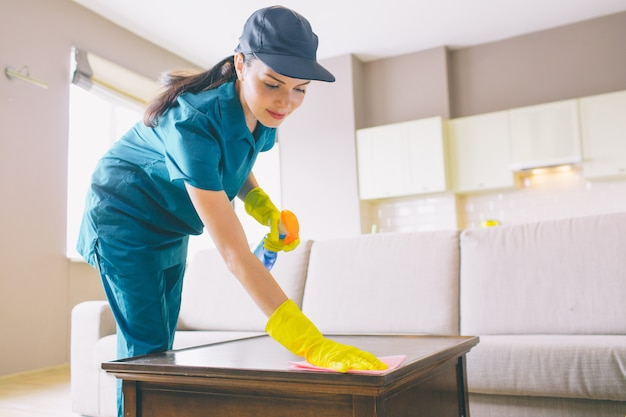 Professional cleaner wahsing surface of table