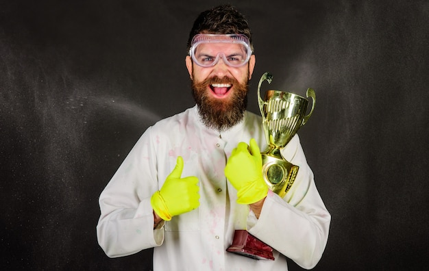 Professional cleaning service. bearded man in uniform and gloves with gold trophy cup.