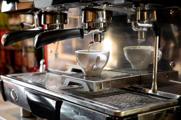 Professional coffee machine pouring espresso