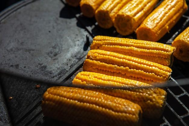 A professional cook prepares corn