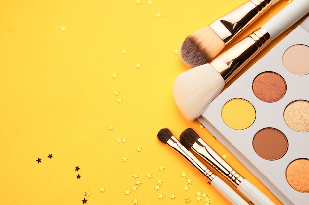 Professional cosmetics palette with eyeshadow makeup brushes