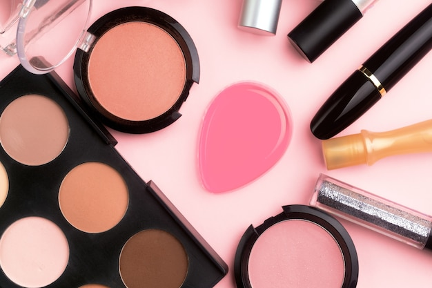 Professional cosmetics on pink table. flat lay, make-up. cosmetic products