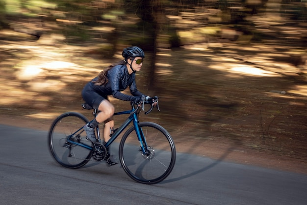 Professional cyclist at high speed on the road with his track bike triathlon concept