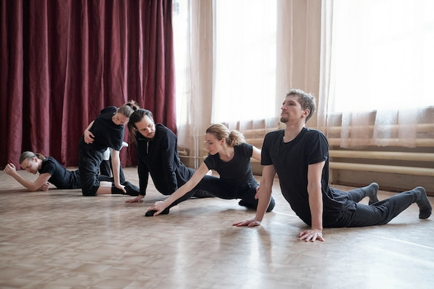 Professional dancers doing stretching exercise