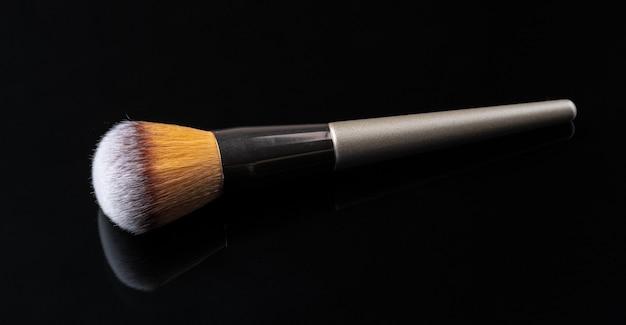 Professional dark make up brush, close up.