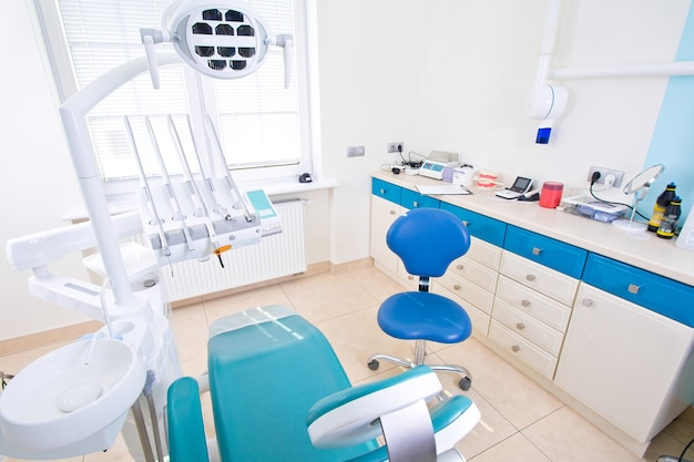 Professional dentist tools and chair in the dental office.