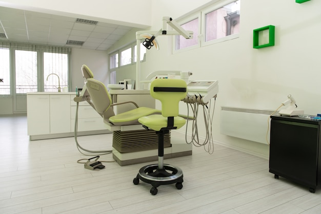 Professional dentist tools and chair in the dental office