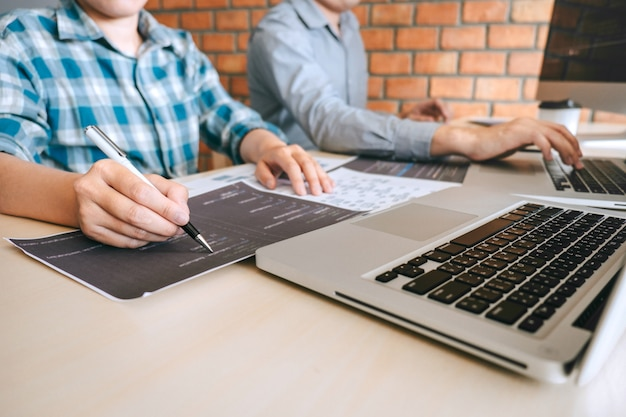 Professional developer programmer cooperation meeting and brainstorming and programming in website working a software outsourcing and coding technology, writing codes and database