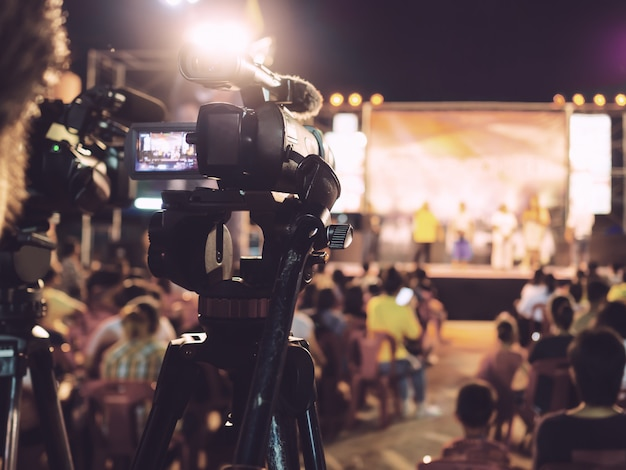 Professional digital camera recording video in music concert