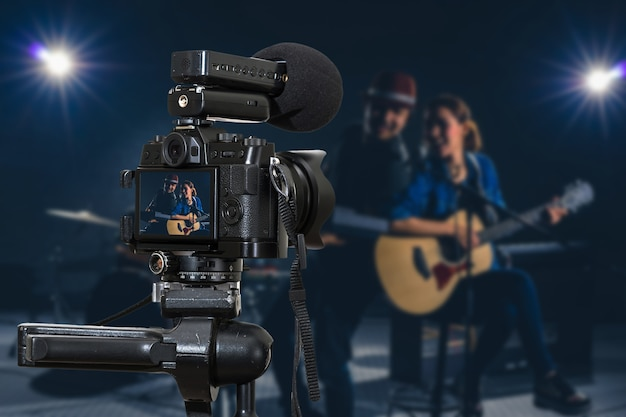 Professional digital mirrorless camera with microphone recording video