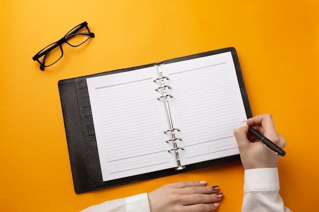 Professional doctor writing medical records in a notebook. top view with place for your text.
