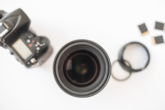 Professional dslr digital camera; camera lens; extension rings and memory cards on white background