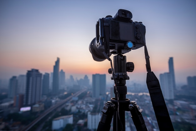 Professional dslr mirrorless camera on a tripod,  taking pictures of the beautiful moments during the sunset ,sunrise.