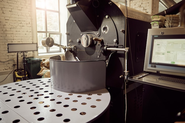 Professional equipment for roasting and cooling fresh coffee beans at factory