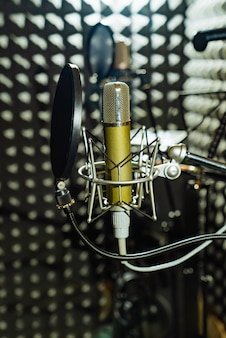 Professional equipment with microphone and shock mount are in the music studio