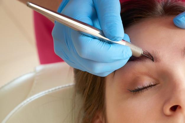 Professional eyebrow correction in beauty salon
